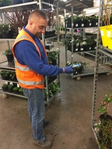 Picture of a man scanning at Farplants