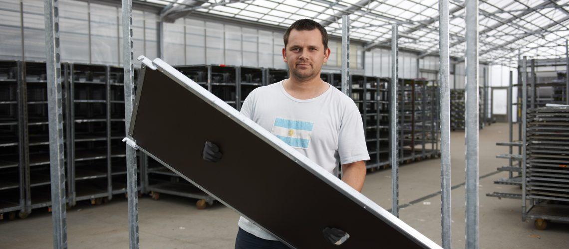 Depot worker handling a CC shelf